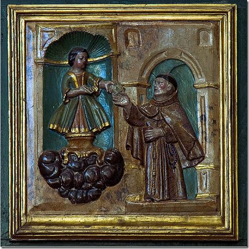 Niño jesus jugando a cartas, entrega el 5 de oros a san juan de padua..